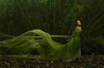 Pacific Islander woman in flowing green dress outdoors